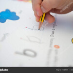 3-Year-Old Child Is Learning To Writetracing Alphabet with regard to 3 Year Old Tracing Letters