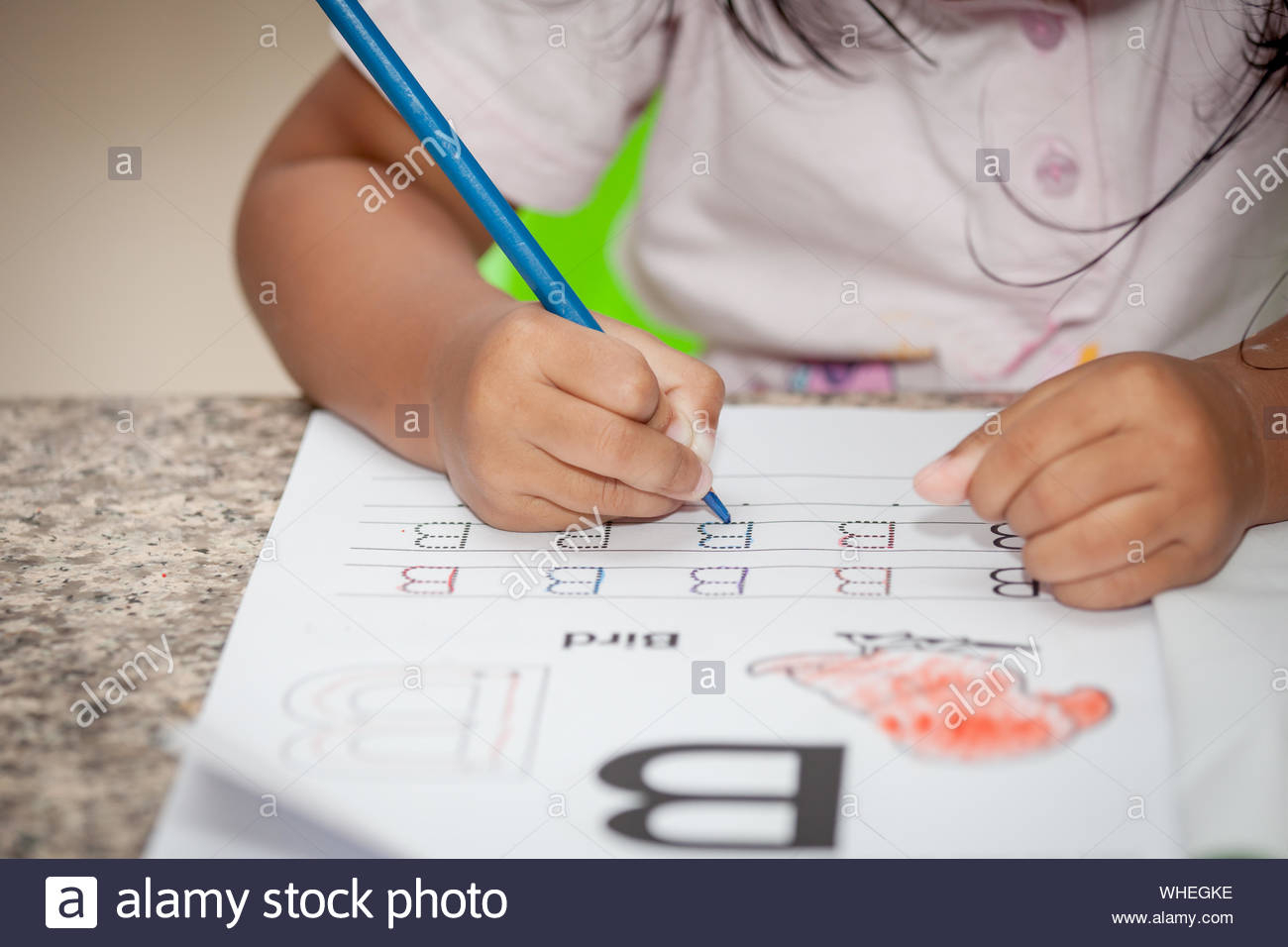 Child Tracing Hand Stock Photos & Child Tracing Hand Stock in Tracing Letters With Fingers