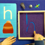 Fostering A Multi-Sensory Approach To Literacy ~ Seeing with Tracing Sandpaper Letters