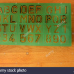 Plastic Stencil Sheet For Tracing Letters And Numbers Stock